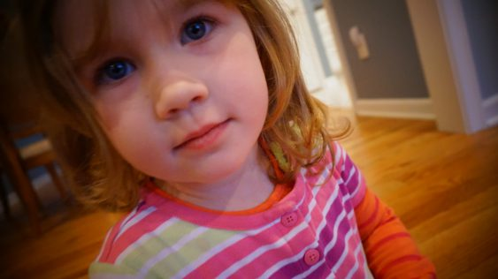 little girl preschooler looking at camera